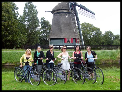 The gang with our grandma bikes out by the windmill in Amsterdam