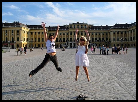 Mel and I tipsy and jumping out the front of the Schonbrunn Palace in Vienna, Austria