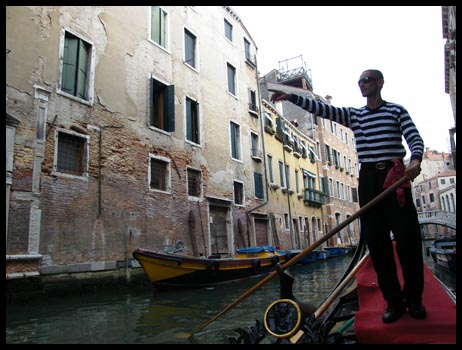 Our gondola guy pointing the real Venice out to us on board