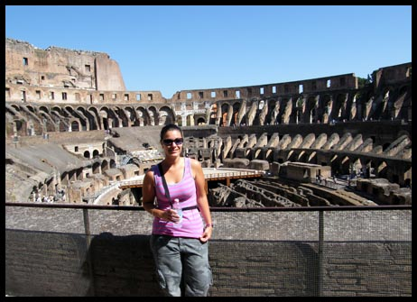Me standing inside the Collesium in Rome, Italy
