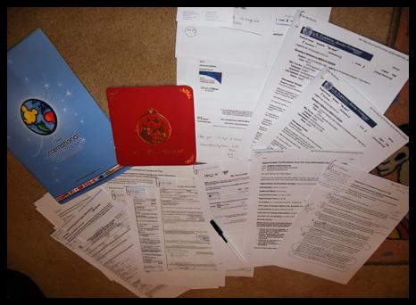 Visa papers taking up my bedroom floor space!
