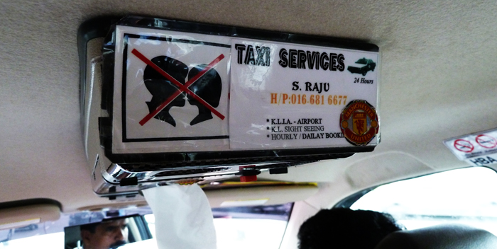 No kissing in the back of this KL cab