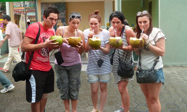 Sipping on coconut water at Batu Caves
